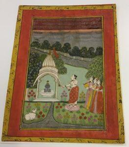 A priest performing a prayer ceremony to Brahma